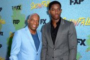 "John Singleton (L) and Damson Idris arrive at the premiere of FX's ""Snowfall"" Season 2 at the Regal Cinemas L.A. LIVE Stadium 14 on July 16, 2018 in Los Angeles, California."