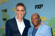 "Executive producer Michael London (L) and John Singleton arrive at the premiere of FX's ""Snowfall"" Season 2 at the Regal Cinemas L.A. LIVE Stadium 14 on July 16, 2018 in Los Angeles, California."