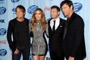 (L-R) Musician Keith Urban, singer Jennifer Lopez, host Ryan Seacrest and singer Harry Connick Jr. arrive at the premiere of Fox's 'American Idol Xlll' at UCLA's Royce Hall on January 14, 2014 in Los Angeles, California.
