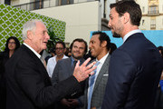 """(L-R) Executive producer Jerry Weintraub with actors Jack Blak, Iqbal Theba, Pablo Schreiber arrive at the Premiere Of HBO's """"The Brink""""  at Paramount Studios on June 8, 2015 in Hollywood, California."""