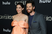 "Lizzy Caplan and Tom Riley attend the premiere of Hulu's ""Castle Rock"" Season 2 at AMC Sunset 5 on October 14, 2019 in Los Angeles, California."