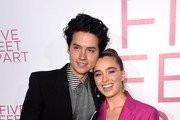 """Cole Sprouse (L) and Haley Lu Richardson arrive at the premiere of CBS Films' """"Five Feet Apart"""" at the Fox Bruin Theatre on March 07, 2019 in Los Angeles, California."""
