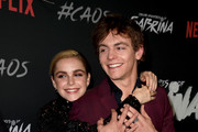 "Kiernan Shipka (L) and Ross Lynch arrive at the premiere of Netflix's ""Chilling Adventures Of Sabrina"" at the Hollywood Athletic Club on October 19, 2018 in Los Angeles, California."