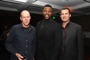"""(L-R) Brian Helgeland, Winston Duke and Scott Stuber pose at the after party for Netflix's """"Spenser Confidential"""" at Baltaire on February 27, 2020 in Westwood, California."""
