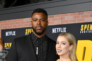 """(L-R) Winston Duke and Iliza Shlesinger attend the Premiere of Netflix's """"Spenser Confidential"""" at Regency Village Theatre on February 27, 2020 in Westwood, California."""