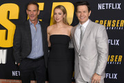 """(L-R) Peter Berg, Iliza Shlesinger, and Mark Wahlberg attend the Premiere of Netflix's """"Spenser Confidential"""" at Regency Village Theatre on February 27, 2020 in Westwood, California."""
