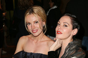 Actresses Bar Paly (L) and Rose McGowan attend the premiere of The Orchard's 'DIOR & I' at LACMA on April 15, 2015 in Los Angeles, California.