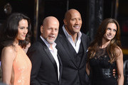 "(L-R) Emma Heming, actor Bruce Willis, Dwayne ""The Rock"" Johnson and Lauren Hashian arrive at the Premiere of Paramount Pictures' ""G.I. Joe: Retaliation"" at TCL Chinese Theatre on March 28, 2013 in Hollywood, California."