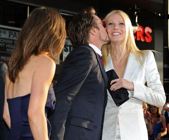 """(L-R) Actor Robert Downey Jr., executive proudcer Susan Downey and actress Gwyneth Paltrow arrive at the world premiere of Paramount Pictures and Marvel Entertainment's """"Iron Man 2? held at El Capitan Theatre on April 26, 2010 in Hollywood, California."""