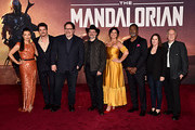 """(L-R) Ming-Na Wen, Pedro Pascal, Executive Producer Jon Favreau, Executive Producer/Director Dave Filoni, Gina Carano, Carl Weathers, Executive Producer Kathleen Kennedy and Werner Herzog arrive at the premiere of Lucasfilm's first-ever, live-action series, """"The Mandalorian,"""" at the El Capitan Theatre in Hollywood, Calif. on November 13, 2019. """"The Mandalorian"""" streams exclusively on Disney+."""