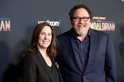 """(L-R) Executive Producer Kathleen Kennedy and Executive Producer Jon Favreau arrive at the premiere of Lucasfilm's first-ever, live-action series, """"The Mandalorian,"""" at the El Capitan Theatre in Hollywood, Calif. on November 13, 2019. """"The Mandalorian"""" streams exclusively on Disney+."""