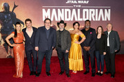 """(L-R) Ming-Na Wen, Pedro Pascal, Showrunner/executive producer Jon Favreau, Executive producer/director Dave Filoni, Gina Carano, Carl Weathers, Executive producer Kathleen Kennedy and Werner Herzog arrive at the premiere of Lucasfilm's first-ever, live-action series, """"The Mandalorian,"""" at the El Capitan Theatre in Hollywood, Calif. on November 13, 2019. """"The Mandalorian"""" streams exclusively on Disney+."""