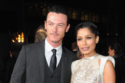 """Actor Luke Evans and actress Freida Pinto arrive at Relativity Media's """"Immortals"""" premiere presented in RealD 3 at Nokia Theatre L.A. Live at Nokia Theatre L.A. Live on November 7, 2011 in Los Angeles, California."""