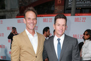 "Peter Berg (L) and Mark Wahlberg attend the premiere of STX Films' ""Mile 22"" at Westwood Village Theatre on August 9, 2018 in Westwood, California."