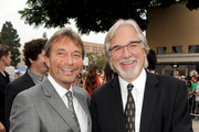 """Lionsgate Motion Picture Group co-chairman Patrick Wachsberger (L) and director Dean Parisot attend the premiere of Summit Entertainment's """"RED 2"""" at Westwood Village on July 11, 2013 in Los Angeles, California."""