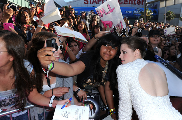 """Kristen Stewart Actress Kristen Stewart poses with fans as she arrives at the premiere of Summit Entertainment's """"The Twilight Saga: Eclipse"""" during the 2010 Los Angeles Film Festival at Nokia Theatre L.A. Live on June 24, 2010 in Los Angeles, California."""