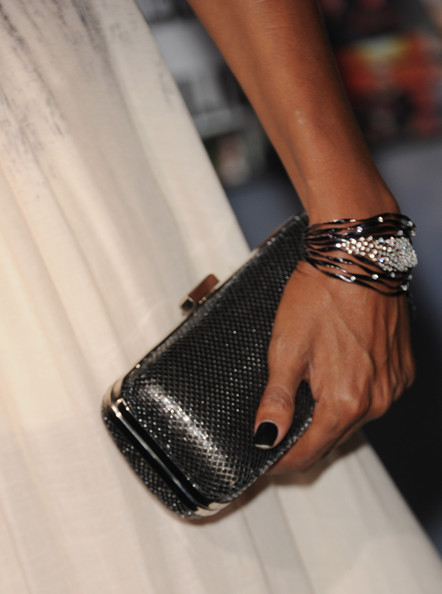 """Actress Judi Shekoni (clutch and jewelry detail) arrives at the premiere of Summit Entertainment's """"The Twilight Saga: Breaking Dawn - Part 2"""" at Nokia Theatre L.A. Live on November 12, 2012 in Los Angeles, California."""