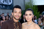 "Actors Justice Smith (L) and Daniella Pineda arrive at the premiere of Universal Pictures and Amblin Entertainment's ""Jurassic World: Fallen Kingdom"" at the Walt Disney Concert Hall on June 12, 2018 in Los Angeles, California."