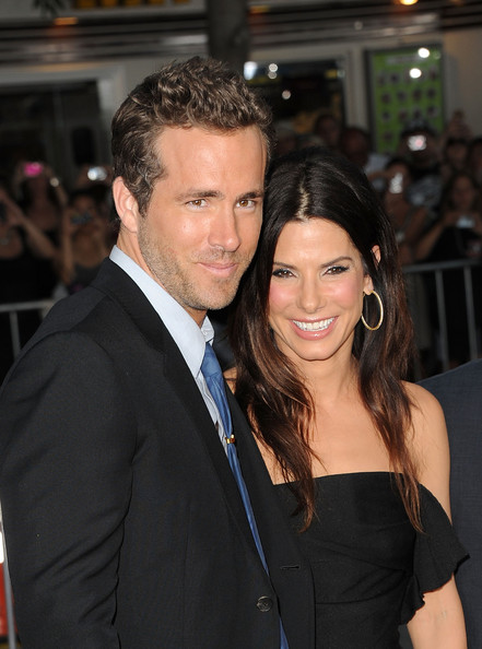 Actors Ryan Reynolds (L) and Sandra Bullock arrive at the premiere of Universal Pictures' 'The Change-Up' held at the Regency Village Theatre on August 1, 2011 in Los Angeles, California.