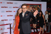 "Actor Robert Downey Jr. (R) and wife Susan Downey attend the premiere of Walt Disney Pictures' ""Iron Man 3"" at the El Capitan Theatre on April 24, 2013 in Hollywood, California."