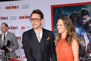 Actors Robert Downey Jr. and Susan Downey attend the premiere of Walt Disney Pictures' 'Iron Man 3' at the El Capitan Theatre on April 24, 2013 in Hollywood, California.