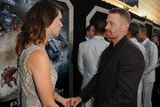 """Actors Heather Doerksen (L) and Max Martini arrive at the premiere of Warner Bros. Pictures' and Legendary Pictures' """"Pacific Rim"""" at Dolby Theatre on July 9, 2013 in Hollywood, California."""