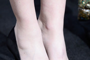 """Singer Lisa Marie Presley, shoe detail, attends the premiere of Warner Bros. Pictures' """"Mad Max: Fury Road"""" at TCL Chinese Theatre on May 7, 2015 in Hollywood, California."""