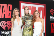 "Annabelle Wallis, Leslie Bibb and Isla Fisher attend the Premiere Of Warner Bros. Pictures And New Line Cinema's ""Tag"" at Regency Village Theatre on June 7, 2018 in Westwood, California."
