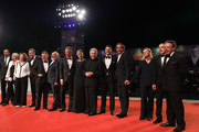 "(2nd-L-R) Josiane Pinson,  Michèle Ray-Gavras , Daan Schuurmans , Cornelius Obonya, Vincent Nemeth, Christos Loulis, Valeria Golino, Costa-Gavras, Alexandros Bourdoumis, Alexandre Desplat, Dominique Lemonnier, Francesco Acquaroli and guest walk the red carpet of the ""Adults In The Room"" premiere as its director Costa-Gavras receives the Jaeger-LeCoultre Glory To The Filmmaker Award and watch during the 76th Venice Film Festival at Palazzo del Cinema on August 31, 2019 in Venice, Italy."