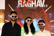 Indian Bollywood actors Vicky Kaushal (L), Sobhita Dhuliwala (C) and Nawazuddin Siddiqui pose for a photograph during a promotional event for the forthcoming Hindi film 'Raman Raghav 2.0' directed by Anurag Kashyap in Mumbai on late May 10, 2016... / AFP / STR