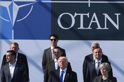 (Front row from L) US President Donald Trump, Britain's Prime Minister Theresa May, (second row from L) Greek Prime Minister Alexis Tsipras, Estonia's Prime Minister Juri Ratas, Polish President Andrzej Duda, (third row from L) Danish Prime Minister Lars Lokke Rasmussen, Canadian Prime Minister Justin Trudeau, and Portuguese Prime Minister Antonio Costa attend the NATO (North Atlantic Treaty Organization) summit ceremony at the NATO headquarters, in Brussels, on May 25, 2017. / AFP PHOTO / Emmanuel DUNAND