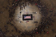 (AFP-OUT) Former President George W. Bush and first lady Laura Bush put their hands on the flag-draped casket of the late former President George H.W. Bush as he lies in state in the Capitol Rotunda on December 4, 2018 in Washington, DC. A WWII combat veteran, Bush served as a member of Congress from Texas, ambassador to the United Nations, director of the CIA, vice president and 41st president of the United States. Bush will lie in state in the U.S. Capitol Rotunda until Wednesday morning.