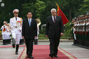 In this handout image provided by the Palestinian Press Office, Vietnam's President Nguyen Minh Triet and Palestinian President Mahmoud Abbas walk past the guard of honor during a Welcoming Ceremy at the Presidential Palace on May 25, 2010 in Hanoi, Vietnam. Abbas is in Vietnam on a official visit from May 24 to 26.