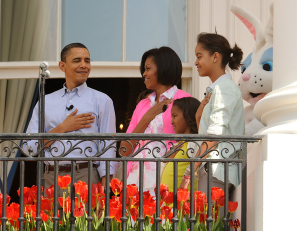 (AFP OUT) (L-R) U.S. President Barack Obama, First Lady Michelle Obama and their daughters Sasha and Malia listen to the National Anthem during the annual White House Easter Egg Roll at the South Lawn April 5, 2010 in Washington, DC. The White House Easter Egg Roll is a tradition dating back to 1878 during the presidency of President Rutherford B. Hayes.