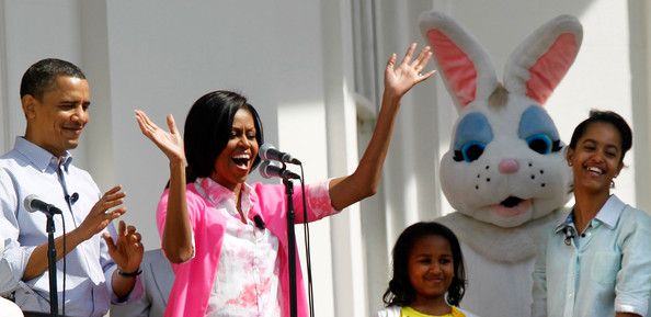 U.S. first lady Michelle Obama (2nd L) speaks from the Truman Balcony as President Barack Obama (L), daughters Malia (R) and Sasha (3rd L) look on during the annual White House Easter Egg Roll at the South Lawn April 5, 2010 in Washington, DC. The White House Easter Egg Roll is a tradition dating back to 1878 during the presidency of President Rutherford B. Hayes.