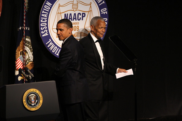 President Barack Obama (L) walks onto stage past Chairman of the NAACP Julian Bond to speak at the NAACP annual convention July 16, 2009 in New York City. Obama discussed the civil rights movement and the importance of carrying on civic responsibility at the 100th anniversary of the nation's oldest civil rights organization.