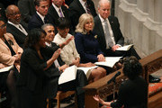 U.S. President Barack Obama, first lady Michelle Obama (C), Dr. Jill BIden (2nd-R) and Vice President Joseph Biden (R),  listen to Michele Fowlin direct the Children of the Gospel Choir during the National Prayer Service at the National Cathedral, on January 22, 2013 in Washington, DC. President Obama was sworn in on January 20 for his second term as President of the United States.