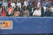 (L-R) Malia Obama, Sasha Obama, first lady Michelle Obama, U.S. President Barack Obama and Cuban President Raul Castro arrive for an exposition game between the Cuban national team and the Major League Baseball team Tampa Bay Devil Rays at the Estado Latinoamericano March 22, 2016 in Havana, Cuba. This is the first time a sittng president has visited Cuba in 88 years.