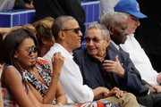 (L-R) Sasha Obama, U.S. first lady Michelle Obama, President Barack Obama and Cuban President Raul Castro attend an exhibition game between the Cuban national baseball team and Major League Baseball's Tampa Bay Devil Rays at the Estado Latinoamericano March 22, 2016 in Havana, Cuba. This is the first time a sittng president has visited Cuba in 88 years.