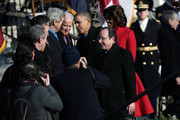 French President Francois Hollande (R) and U.S. President Barack Obama (C) greet guests during a welcoming ceremony on the South Lawn at the White House on February 11, 2014 in Washington, DC. Hollande who arrived yesterday for a three day state visit, visited Thomas Jefferson's Monticello estate and will be the guest of honor for a state dinner tonight.
