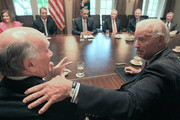 U.S. Vice President Joe Biden (R) talks with White House Chief of Staff Bill Daley (L), while U.S. President Barack Obama (4th L)) meets with (L-R), House Minority Leader Nancy Pelosi (D-CA), House Speaker John Boehner (R-OH), Senate Majority Leader Harry Reid (D-NV), Senate Minority Leader Mitch McConnell (D-KY),and Sen. Dick Durbin (D-IL), in the Cabinet Room of the White House in Washington, DC. President Obama is continuing to meet with Congressional leaders in hopes of coming to an agreement on raising the nations dept limit.