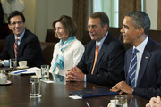 U.S. President Barack Obama (R) meets with congressional leaders including House Speaker John Boehner (R-OH) (2nd R),  House Minority Leader Nancy Pelosi (D-CA) (2nd L), and House Majority Leader Eric Cantor (R-VA) in the Cabinet Room of the White House July 7, 2011 in Washington, D.C. The Obama administration and congressional leaders are attempting to hammer out a deal that would lower the deficit as a House Republican majority stipulation for a vote on increasing the nation's debt ceiling.