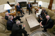 U.S. President Barack Obama and Vice President Joe Biden meets with House Democratic leaders, including Minority Leader Nancy Pelosi (D-CA), Minority Whip Steny Hoyer (D-MD), Rep. James Clyburn (D-SC), Rep. Steve Israel (D-NY), Rep. Xavier Becerra (D-CA), House Budget Committee ranking member Rep. Chris Van Hollen (D-MD) and Rep. Joseph Crowley (D-NY) in the Oval Office at the White House October 15, 2013 in Washington, DC. Negotiations between Congressional Republicans and Democrats and the White House continue as the federal debt limit looms and the partial shutdown of the federal government moves into its third week.