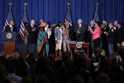 U.S. House Minority Leader Rep. Nancy Pelosi (D-CA) (C-R) hugs trafficking survivor Tysheena Rhames (C-L) as President Barack Obama (L), Vice President Joseph Biden (3rd L) and other guests look on during a bill signing ceremony of the Violence Against Women Act at the Department of the Interior March 7, 2013 in Washington, DC. The law expands protections for victims of domestic violence, sexual assault and trafficking.