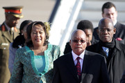 South African President Jacob Zuma and Thobeka Madiba Zuma (l), his newest of three wives, arrive at Heathrow airport on March 2, 2010 in London, England. Mr Zuma and his wife are beginning a three-day state visit to the UK during which they are due to meet the Queen at Buckingham Palace and visit the Olympic Park site.