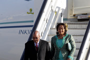 South African President Jacob Zuma and Thobeka Madiba Zuma, his newest of three wives, arrive at Heathrow airport on March 2, 2010 in London, England. Mr Zuma and his wife are beginning a three-day state visit to the UK during which they are due to meet the Queen at Buckingham Palace and visit the Olympic Park site.