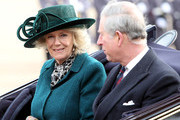 Camilla, Duchess of Cornwall and Prince Charles, Prince of Wales travel in a carriage during a ceremonial welcome for South African President Jacob Zuma on Horseguards Parade on March 3, 2010 in London, England. The South African Leader is on a three day State visit to Britain.