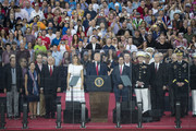 "President Donald Trump, First Lady Melania Trump, Vice President Mike Pence and Second Lady Karen Pence stand on stage after President Donald Trump spoke at the ""Salute to America"" ceremony in front of the Lincoln Memorial, on July 4, 2019 in Washington, DC. The presentation featured armored vehicles on display, a flyover by Air Force One, and several flyovers by other military aircraft."