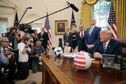 (R-L) U.S. President Donald Trump makes brief remarks to reporters during a meeting with U.S. Soccer President Carlos Cordeiro and FIFA President Gianni Infantino in the Oval Office at the White House August 28, 2018 in Washington, DC. The 2026 FIFA World Cup will be jointly hosted by the United States, Canada and Mexico and will be the first World Cup in history to be held in three countries at the same time.