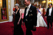 British Prime Minister Theresa May and Prince William, Duke of Cambridge followed by Catherine, Duchess of Cambridge and United States Secretary of the Treasury, Steven Mnuchin arrive through the East Gallery for a State Banquet at Buckingham Palace on June 3, 2019 in London, England. President Trump's three-day state visit will include lunch with the Queen, and a State Banquet at Buckingham Palace, as well as business meetings with the Prime Minister and the Duke of York, before travelling to Portsmouth to mark the 75th anniversary of the D-Day landings.